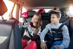 Winter holiday, ski, travel - kids enjoying in traveling to ski. Winter holiday, ski, travel – smiling kids enjoying in traveling to ski resort making selfie Stock Photos