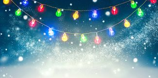 Winter holiday snow background decorated with colorful light bulbs garland. Snowflakes. Christmas and New Year abstract backdrop stock photography
