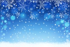 Winter holiday snow bokeh background. Abstract christmas defocused backdrop with snowflakes Royalty Free Stock Images