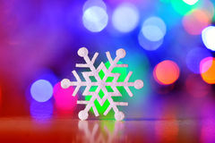 Winter Holiday Snow flake Background, Bokeh.  Stock Photo