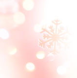 Winter holiday snow flake pink background, bokeh Stock Photography