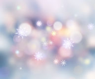 Winter holiday snowflakes abstract blur background. Stock Photos