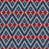 Winter Holiday sweater design on the wool knitted texture Stock Photos