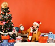 Winter holiday and technologies concept. Santa Claus talks on phone. Winter holiday and technologies concept. Santa Claus talks on mobile phone near fir tree on royalty free stock photography
