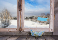 Winter holiday traveller concept: Wooden window sill with sail b Stock Images