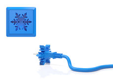 Winter holiday or wintertime sale season creative concept. Winter creative concept. Electric plug and power socket as blue snowflake as the beginning of holiday Stock Photos