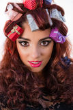 Winter holiday woman with gifts in her hair Stock Image