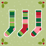 Winter holidays background with colorful baby socks for gifts fr Royalty Free Stock Photo