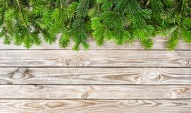 Winter holidays border Christmas tree branches. Winter holidays border. Christmas tree branches on wooden background Stock Photos