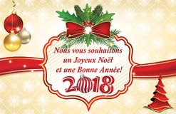 Winter holidays business greeting card written in French. Winter holidays business greeting card in French. Text translation: We wish you Merry Christmas and a Stock Photo