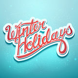 Winter holidays christmas lettering on a blue background Royalty Free Stock Photos