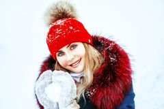 Woman holding snowball. Winter holidays, christmas and people concept - close up of woman holding snowball outdoors stock image