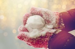 Close up of woman holding snowball outdoors. Winter holidays, christmas and people concept - close up of woman holding snowball outdoors Stock Photography