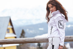 Winter holidays - female in winter resort Stock Images