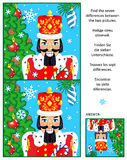 Winter holidays find the differences picture puzzle with nutcracker. New Year or Christmas visual puzzle: Find the seven differences between the two pictures of Royalty Free Stock Photography