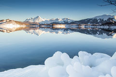 Winter holidays in the ice lake Royalty Free Stock Image