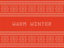 Winter holidays knitted pattern with snowflakes and reindeers Royalty Free Stock Images