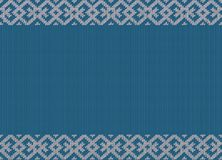 Winter holidays knitted pattern with snowflakes and reindeers Royalty Free Stock Photos