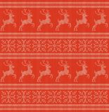 Winter holidays knitted pattern with snowflakes and reindeers Stock Image