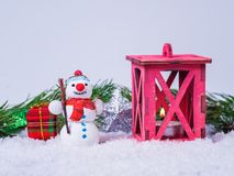 Winter holidays with lantern and snowfall stock photos