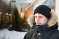 Winter holidays - man in cap and warm jacket Stock Photos