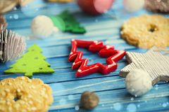 Winter holidays ornaments for the Christmas tree on painted wood. Board, selective focus of tree Christmas ornament stock photography