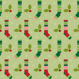 Winter holidays pattern background with colorful baby socks for Royalty Free Stock Photo