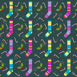 Winter holidays pattern background with colorful baby socks for Stock Photo