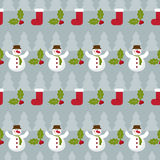 Winter holidays pattern background with fir, branch of Holly and Royalty Free Stock Photography