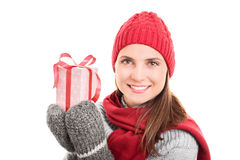 Winter, holidays and presents. Beauty portrait of a young woman wearing winter clothes and holding a present isolated on white background Royalty Free Stock Photography