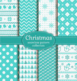 Winter holidays seamless patterns. Vector set. Merry Christmas and Happy New Year! Winter holidays seamless backgrounds set with mittens, christmas tree Royalty Free Stock Images