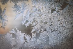 Winter Holidays Season Fantasy World Concept: Colorful Macro Image Of A Frosty Window Glass Natural Ice Patterns With Copy Space.  stock photo