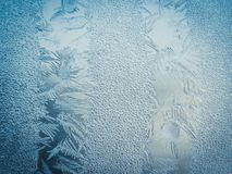 Winter Holidays Season Fantasy World Concept: Macro Image Of A Blue Frosty Window Glass Natural Ice Patterns With Copy Space.  stock images
