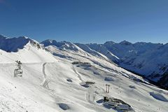 Winter holidays between snow-covered Swiss mountains. Davos, Switzerland royalty free stock photo