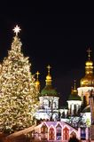 Winter holidays on Sophia square in Kyiv. St. Sophia Cathedral, Christmas market, and main Kyiv's New Year tree on Sophia Square in Kyiv, Ukraine Royalty Free Stock Photography