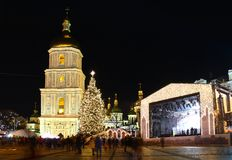 Winter holidays on Sophia square in Kyiv. St. Sophia Cathedral, Christmas market, and main Kyiv's New Year tree on Sophia Square in Kyiv, Ukraine Stock Photography