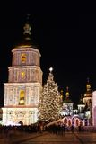 Winter holidays on Sophia square in Kyiv. St. Sophia Cathedral, Christmas market, and main Kyiv's New Year tree on Sophia Square in Kyiv, Ukraine Stock Image