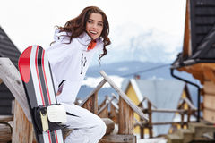 Winter holidays - woman in winter resort Royalty Free Stock Photography