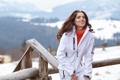 Winter holidays - woman in winter resort Royalty Free Stock Images