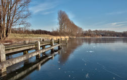 Winter in holland. Frozen river in winter in Holland royalty free stock photo