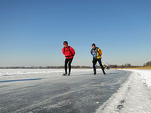 Winter in Holland. Giethoorn, Netherlands - February 6, 2012. Ice skaters in Dutch winter landscape Stock Images