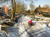 Winter in Holland. Giethoorn, Netherlands - February 6, 2012. Ice skaters in Dutch winter landscape Royalty Free Stock Image