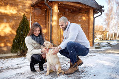 Winter holyday with dog on mountain. Man and women spend winter holyday with dog on mountain Stock Photos