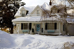 Winter Home. Idyllic farm home in winter time Stock Photo