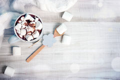 Winter home background cocoa mug on wooden table. royalty free stock image