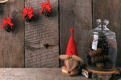 Winter home decor. Christmas rustic interior. Farmhouse decoration style. decorative gnome and a jar of cones. Winter home decor. Christmas rustic interior stock photo