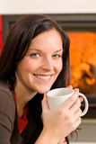 Winter home fireplace woman drink hot coffee Stock Photography
