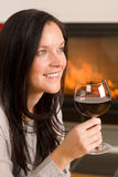 Winter home fireplace woman glass red wine Royalty Free Stock Photography