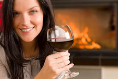 Winter home fireplace woman glass red wine Stock Images