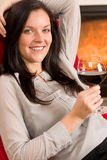 Winter home fireplace woman glass red wine Stock Photo